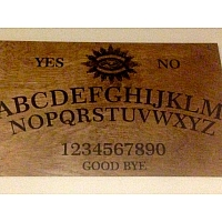 laser cut Ouija board made at Hexlab Makerspace!